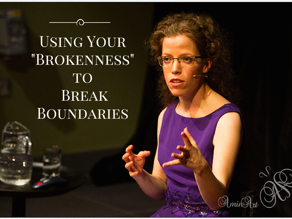 speaker grace quantock in purple dress and wheelchair on stage white text using your brokenness to break boundaries