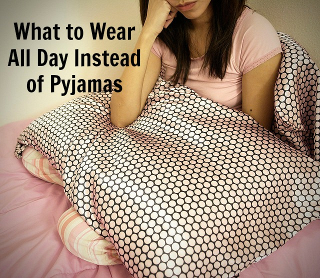 what to wear all day instead of pjjamas black text on image of girl with pink pyjamas and a pink spotty pillow sitting in bed