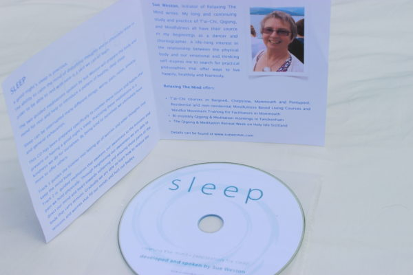 Sleep meditation CD in clear case, with sleeve notes displayed behind.