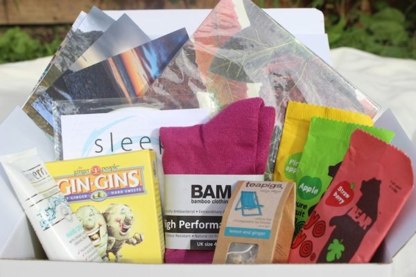 Healing box with lots of gifts bursting out, nicluding ginger sweets, tea, socks and more