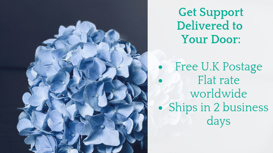 Get comfort delivered to your door: free UK shipping, flat rate worldwide - green text over photo of powder blue hydranger